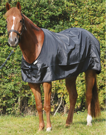 Bossy's Bibs Rug Guard, a lightweight protective layer between top rug and coat. Prevents hip, shoulder, wither and chest rubs. Protects rug from grease and hair build up.