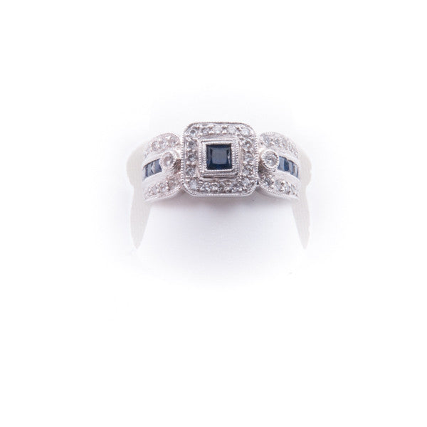 LADIES .37CT DIAMOND .76CTSAPPHIRE 4.9 GRAMS RING IN 18KW, this is New Item #36250