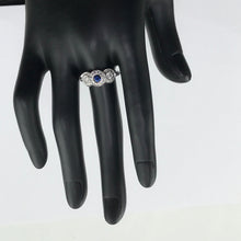 HALO DIAMOND AND SAPPHIRE RING