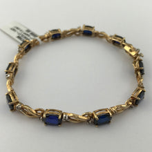 "10 Oval-shaped Blue Sapphire and Diamond 7.25"" Tennis Bracelet in 14K Yellow Gold, Pre-owned item #297986"