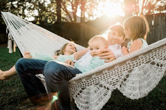 family on a hammock in the backyard