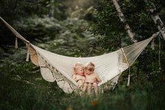 kids on a hammock in the forest