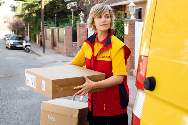 blonde DHL woman delivering a pack