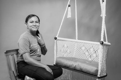 hang a hammock collective artisan and her product (hanging chair) - studio picture
