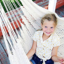 kid on hammock chair