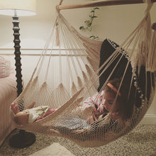 kid sleeping on hammock chair