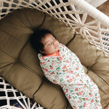 baby on a mattress in a cradle - top view
