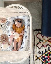 baby in a hanging cradle - top view