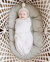 baby in a bassinet - top view