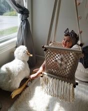 Example of a nursery room with baby swing chair in macrame - ivory color - cream pillow