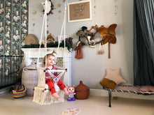 Example of a nursery room with baby swing chair in macrame - ivory color - cream pillow - two hanging points