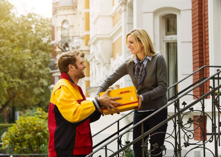 DHL EXPRES courier man delivery a package to a woman