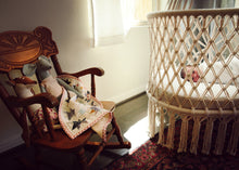 hanging cradle and a old rocking chair near by