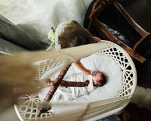 baby sleeping in a hanging cradle - picture from the top