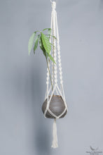 Plant Hanger in Macrame holding a plant - Cream color- Model 01 - styled photo