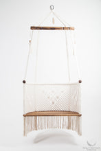 hanging chair in wood and cotton. studio photo. front view