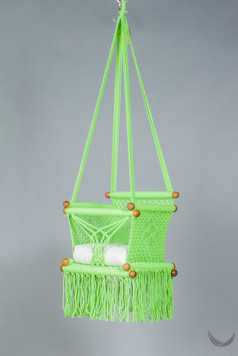 swing chair in macrame - pistachio color - with cream cushion - studio photo