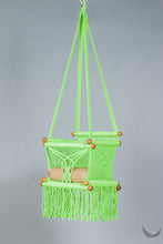 swing chair in macrame - pistachio color - with beige cushion - studio photo