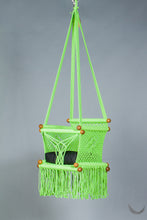 swing chair in macrame - pistachio color - with black cushion - studio photo