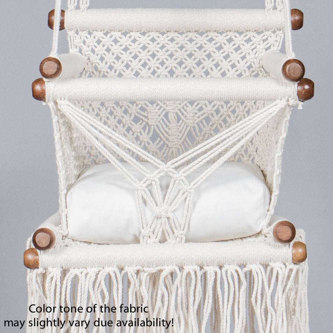 detail of a white cushion on a baby swing chair