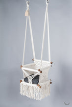 baby swing chair in macrame - ivory color - black pillow - two hanging points - studio photo