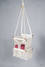 baby swing chair in macrame - ivory color - red pillow - studio photo