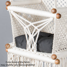 detail of a black cushion on a baby swing chair