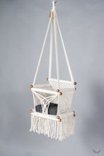 baby swing chair in macrame - ivory color - black pillow - studio photo