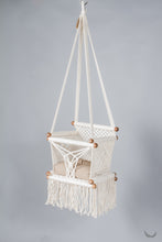 baby swing chair in macrame - ivory color - beige pillow - studio photo