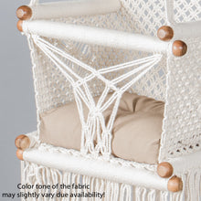 detail of a beige cushion on a baby swing chair