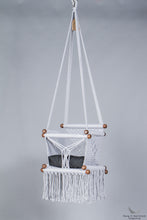 baby swing chair in grey - black cushion - studio picture