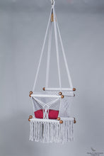 baby swing chair in grey - red cushion - studio picture