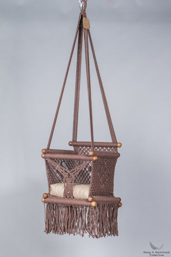baby swing chair in brown - khaki cushion - studio picture