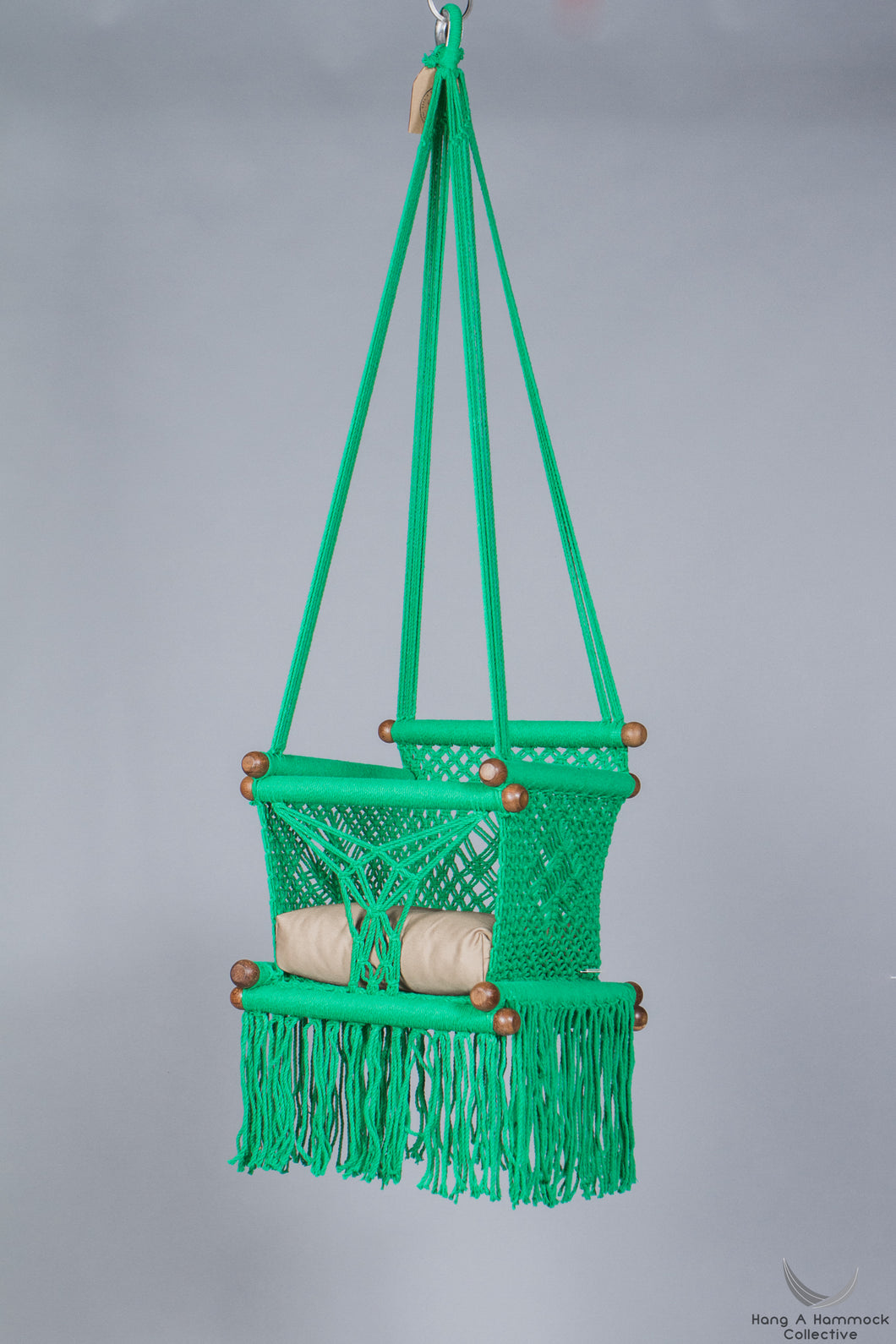 swing chair in green - khaki cushion - studio picture