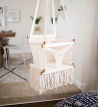 baby swing chair in macrame - styled photo kids room angle view