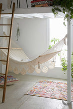 indoor handwoven hammock under a mezzanine