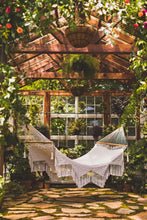 Yucatan hammock in a green house - vertical picture