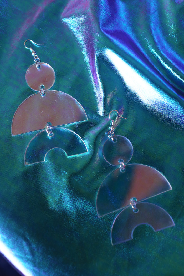 Lightweight and comfortable laser cut holographic large shape earrings by artist Amada Miller
