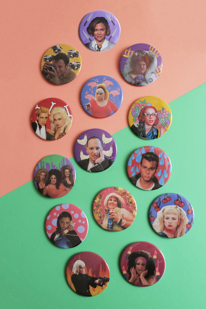 A set of buttons based on director John Waters