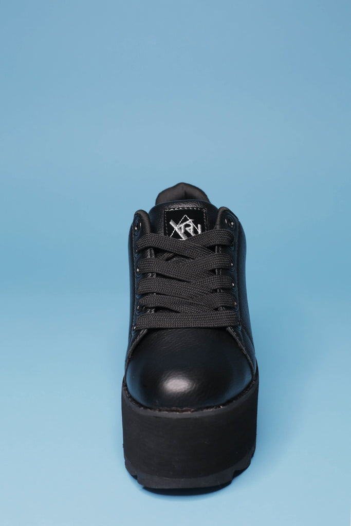 All black YRU LaLa platform sneakers with black laces