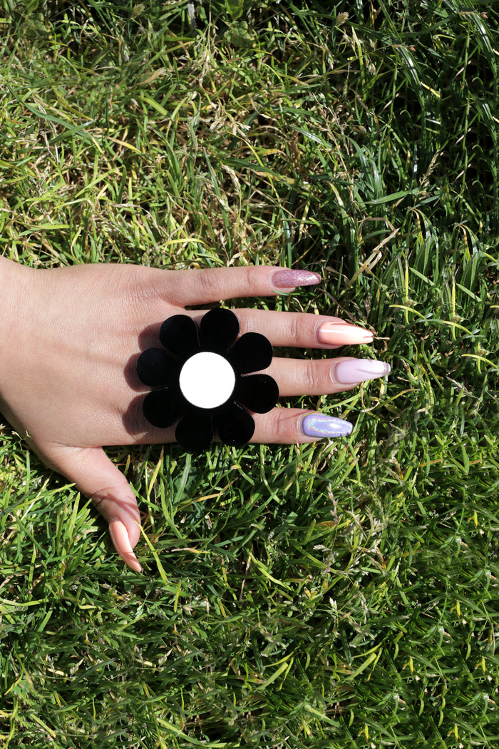 Marina Fini plexiglass laser cut oversized black and white flower power ring