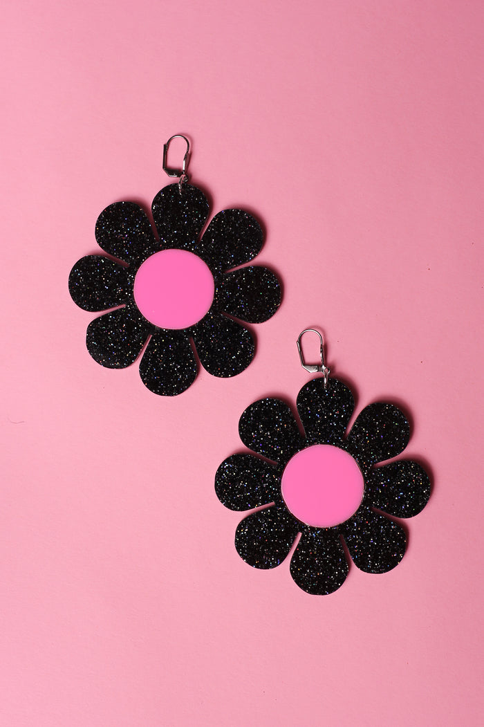 pink and black glitter flower power earrings by designer marina fini