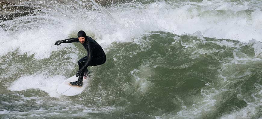 Why Wear a Wetsuit While Surfing?
