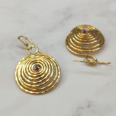 Picture of the front and back of our handmade, reflective 14 KT gold-filled spiral crystal earrings. | Made in MT