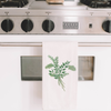 Picture of a dish towel with a watercolor painting of a eucalyptus branch | Made in New Jersey | LocalWe