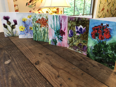 Set of six cards with flower paintings propped up on a table  | Made in NC | LocalWe