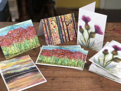 Table full of greeting cards with prints of paintings on them | Made in NC | LocalWe