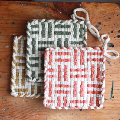 An arrangement of lovely cotton handwoven potholders in spice, willow and ochre colors.