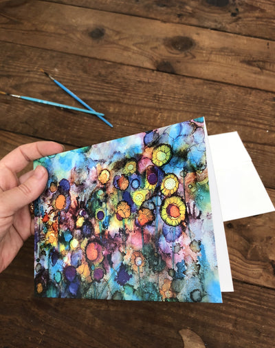 Side view image of the Field of Flowers greeting card picturing a vibrant field of abstract flowers against a cool watercolor background.
