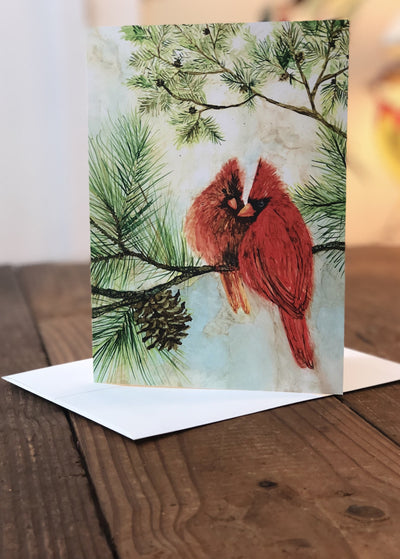 Cardinal Lovebirds prints featuring two cardinals on a pine tree branch available in greeting cards; crafted in NC | LocalWe
